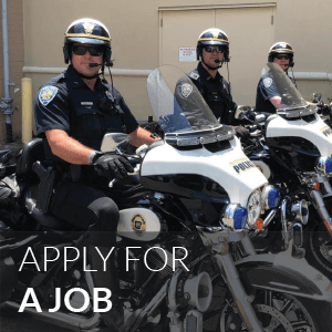 Button image featuring three uniformed police officers on motorcycles: Apply for a Job