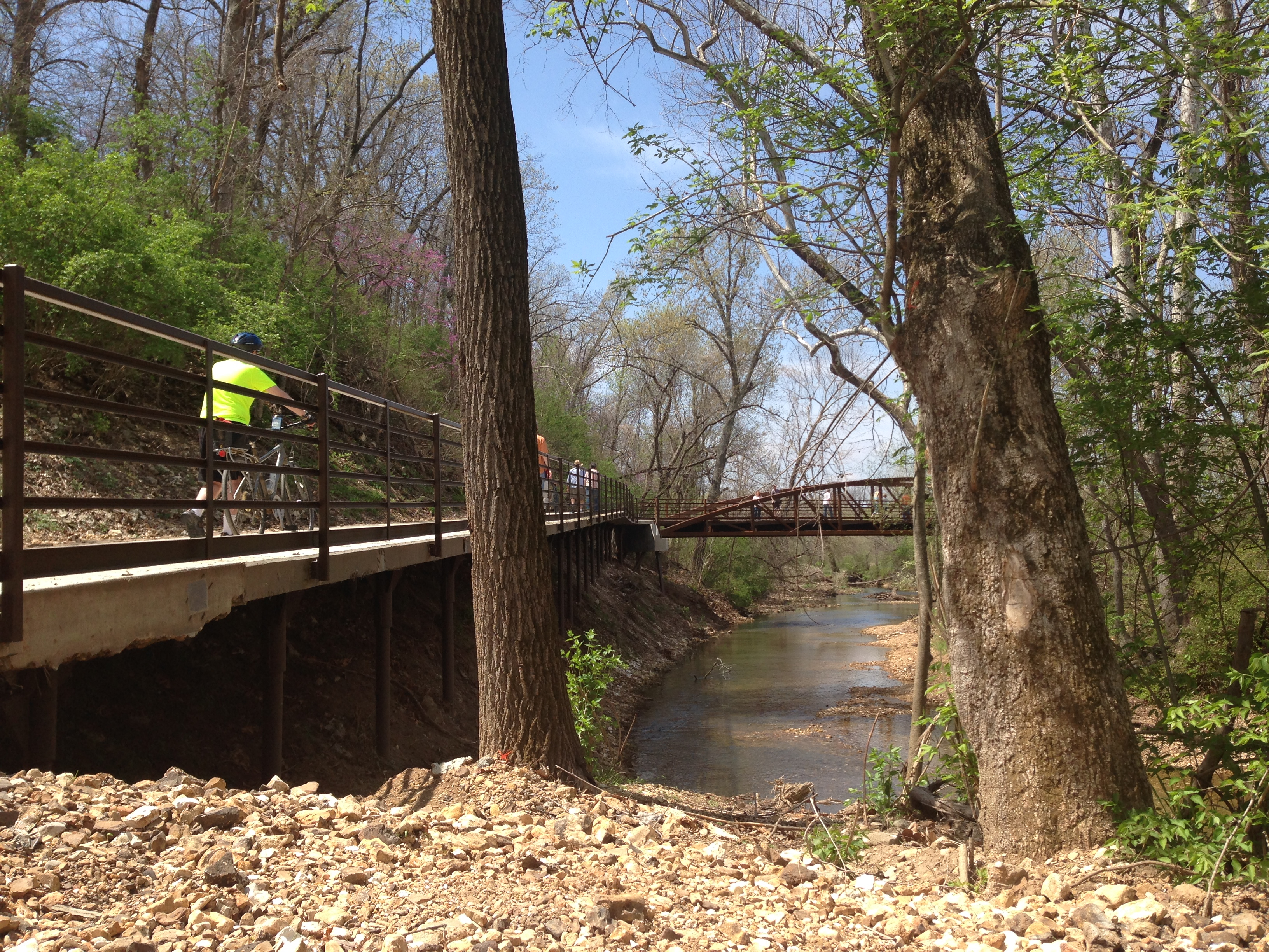 People cross bridge on Clear Creek Trail