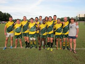 Rugby team joins together to pose for photo on the field