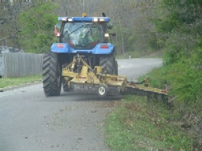 Tractor mowing a ditch